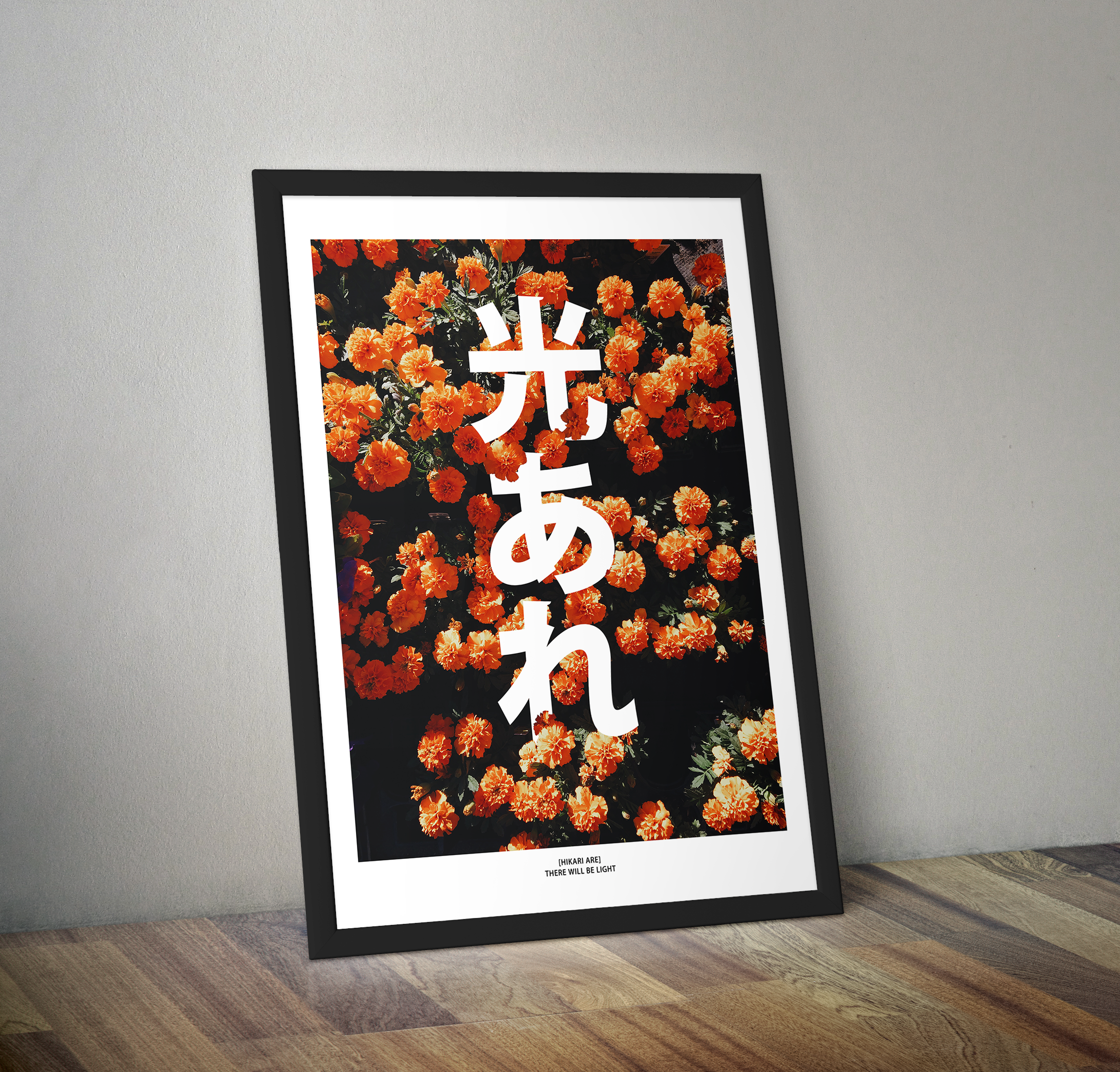 A framed poster rests against a wall. The poster depicts orange flowers partly covering big white Japanese characters that spell out the words Hikari are.